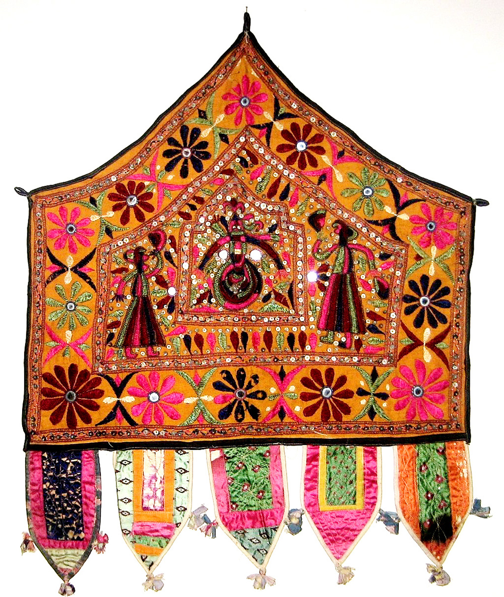 Alter_Cloth_(Toran),_Saurashtra,_Gujarat,_India,_20th_Century,_cotton,_metal_and_mirror_pieces._plain_weave_with_embroidery_and_mirror_work,_Honolul